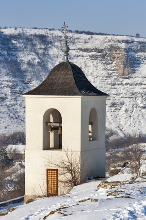 winter Orhei Vechi monastery bell tower in Moldova photo