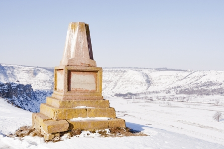 unknown old monument over Orhei Vechi winter valley in Moldova photo