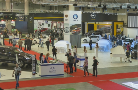 manufacturers: KIEV, UKRAINE - MAY 29: Visitors visit exhibition boothes of different international car manufacturers with new car models on display of SIA 2013 Kyiv International Motor Show in International Exhibition Centre on May 29, 2013 in Kiev, Ukraine.