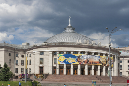 KIEV, UKRAINE - JUNE 05: Pedestrians walk along the building of Kiev Circus opened in 1960 on June 05, 2013 in Kiev, Ukraine. Circus for up to 1,907 places was designed by architect V. Zhukov in 1950.