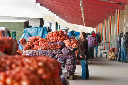 implemented: KIEV, UKRAINE - OCTOBER 20: Buyer eyeing on the vegetable food market Stolichniy (Metropolitan), wholesale modern facility that is implemented in the form of multi-logistics complex on October 20, 2013 in Kiev, Ukraine.