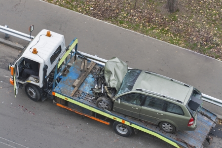 traffic accidents: car broken during a road accident shipped to a car wrecker