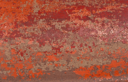 surface of cracked old red paint background photo