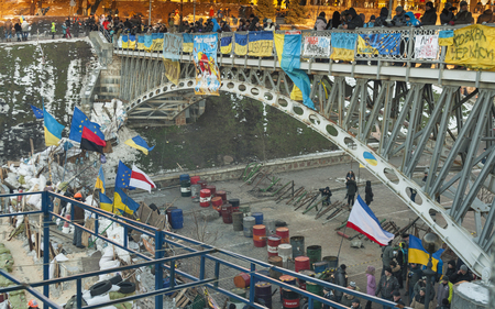 barricades:  KIEV, UKRAINE - DECEMBER 14: Demonstrators guard EuroMaidan barricades on Institutska street during peaceful protests against the Ukrainian president and government on December 14, 2013 in Kiev, Ukraine. The protests were provoked when the Ukrainian pres
