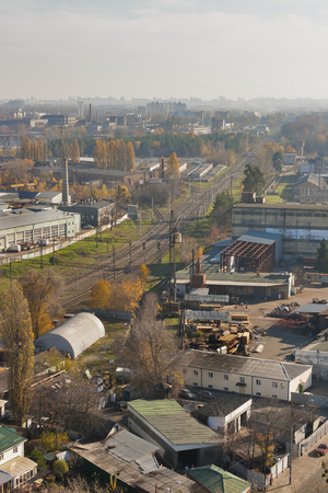 view from the height over industrial district with railroad photo