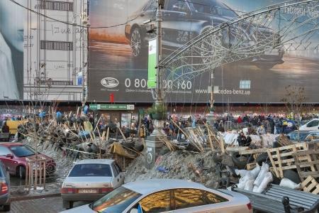 demonstrators: KIEV, UKRAINE - DECEMBER 14: Demonstrators on EuroMaidan guard barricades on Khreshchatyk street during peaceful protests against the Ukrainian president and government on December 14, 2013 in Kiev, Ukraine. The protests were provoked when the Ukrainian p Editorial