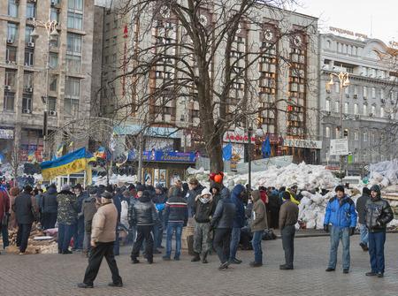 barricades: KIEV, UKRAINE - DECEMBER 14: Demonstrators guard EuroMaidan barricades on Khreshchatyk street during peaceful protests against the Ukrainian president and government on December 14, 2013 in Kiev, Ukraine. The protests were provoked when the Ukrainian pres Editorial