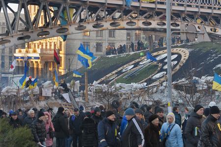 demonstrators: KIEV, UKRAINE - DECEMBER 14: Demonstrators guard EuroMaidan barricades on Institutska street during peaceful protests against the Ukrainian president and government on December 14, 2013 in Kiev, Ukraine. The protests were provoked when the Ukrainian presi