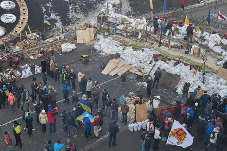 provoked: KIEV, UKRAINE - DECEMBER 14: Demonstrators guard EuroMaidan barricades on Institutska street during peaceful protests against the Ukrainian president and government on December 14, 2013 in Kiev, Ukraine. The protests were provoked when the Ukrainian presi