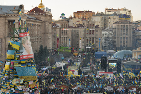 provoked: KIEV, UKRAINE - DECEMBER 14: Demonstrators protest on Independence Square EuroMaidan during peaceful actions against the Ukrainian president and government on December 14, 2013 in Kiev, Ukraine. The protests were provoked when the Ukrainian president deni Editorial