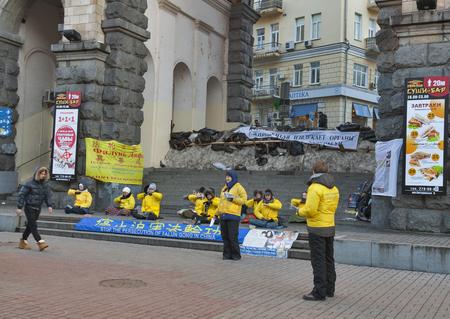 persecution: KIEV, UKRAINE - DECEMBER 14: Followers of spiritual discipline Falun Gong protest against persecution in China during EuroMaidan public protests on December 14, 2013 in Kiev, Ukraine.