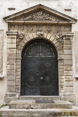 bas relief: Ancient medieval door with bas relief Stock Photo
