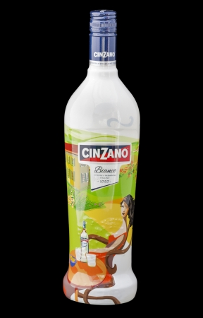 sweet vermouth: KIEV, UKRAINE - AUGUST 26, 2012: Cinzano Bianco sweet vermouth bottle isolated on black. Cinzano vermouths were founded 1757 by two brother: G. Giacomo and C. Cinzano. Cinzano brand owned since 1999 by Gruppo Campari..Cinzano Bianco vermouth is based on a
