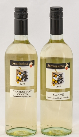 KIEV, UKRAINE - AUGUST 26, 2012: Bottles of Italian wine Serenissima Chardonnay Veneto and Soave against white background. The Veneto alone produces more than 53 million gallons of wine every year – more than any other region in Italy.