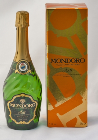 KIEV, UKRAINE - APRIL 30, 2012: Bottle and box of Mondoro Asti Italian Sparkling Wine against white background. Mondoro Asti sparkling wine of superior quality by Gruppo Campari. Asti is set in the gently rolling hills of Piedmont, Northern Italy. Made fr Editorial