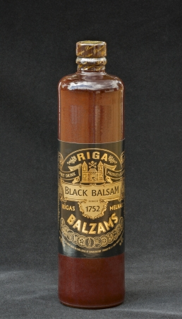 KIEV, UKRAINE - JUNE 29, 2012  Herb hard liqueur Riga Black Balsam bottle  Riga Black Balsam is a traditional Latvian herbal liqueur made with many different natural ingredients mixed in pure vodka, 45  drink  The traditional recipe was created by pharmac
