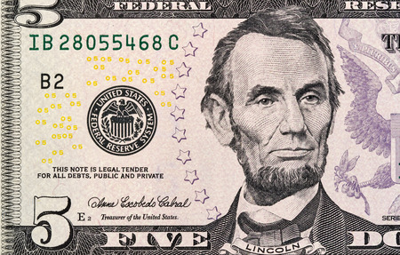 five dollars: Portrait of Lincoln from five dollars bill new edition macro