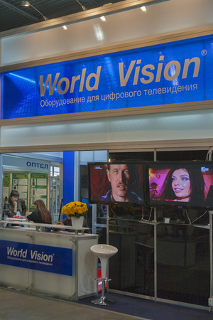 Visitors visit World Vision satellite digital equipment booth at Kyiv International exhibition and conference in broadcast industry 2012 in Kiev, Ukraine. EEBC is the largest in Ukraine international exhibition and conference of broadcast industry.