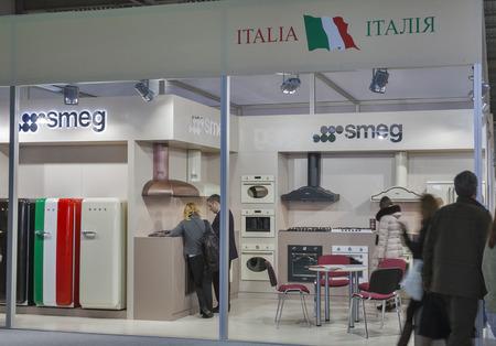 hobs: Visitors visit Smeg Italian home appliance manufacturer booth display at Kiev International Furniture Forum at Kyiv Expo Plaza Exhibition Center in Kiev, Ukraine