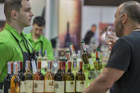 wino: People tasting wine during the Ukrainian festival Polyana Wino Fest 2013 in in Kiev, Ukraine Editorial