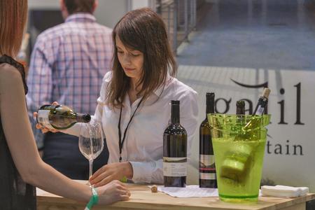 wino: Tasting wine during the Ukrainian festival Polyana Wino Fest 2013 in in Kiev, Ukraine