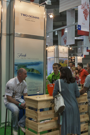 wino: People tasting wine at Two Oceans booth during the Ukrainian festival Polyana Wino Fest 2013 in in Kiev, Ukraine. Two Oceans is a South African premium wine brand.