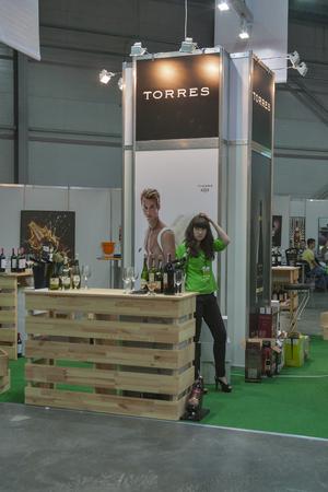 wino: Torres Spanish wine tasting booth with presenter during the Ukrainian festival Polyana Wino Fest 2013 in in Kiev, Ukraine Editorial
