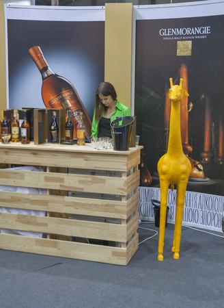 wino: Glenmorangie Single Malt Scotch whisky tasting booth with presenter during the Ukrainian festival Polyana Wino Fest 2013 in in Kiev, Ukraine. Glenmorangie is categorised as a Highland distillery and boasts the tallest stills in Scotland.