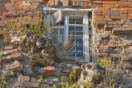 Window with grates of old building in Vinnitsia, Ukraine photo
