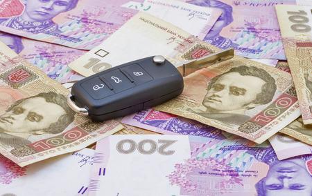 hryvna: Car keys over the hryvna Ukrainian banknotes