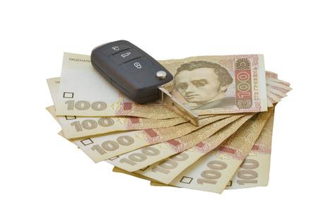 hryvna: Car keys over the hryvna Ukrainian banknotes isolated on white Stock Photo