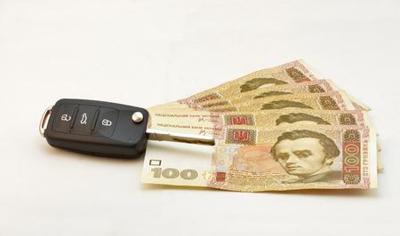 hryvna: Car keys over the hryvna Ukrainian banknotes on white Stock Photo