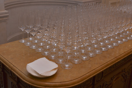 Empty champagne glasses on a marble table for buffet photo