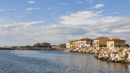 Marina di Pisa sunset view of the town waterfront. Tuscany, Italy. photo