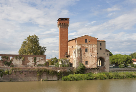 The Guelph Tower and Medici Citadel on the Arno River in Pisa, Tuscany, Italy. photo
