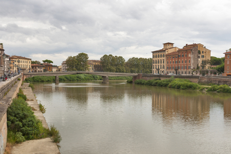 fortezza: Ponte della Fortezza over Arno River and waterfront buildings, Pisa. Tuscany, Italy. Stock Photo