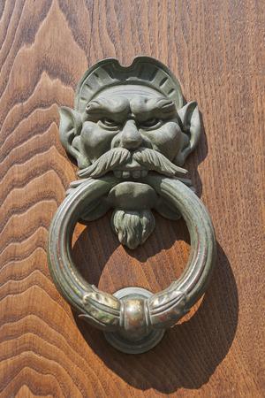 Old metal door knocker closeup photo