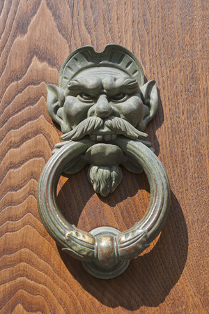 Old metal door knocker closeup photo