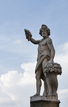bacchus: Statue of Autumn, or Bacchus in Holy Trinity Bridge of Florence, Italy.