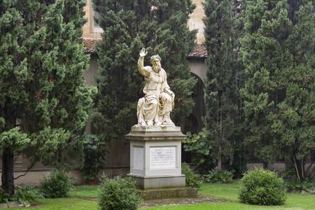 santa cross: Basilica di Santa Croce or Basilica of the Holy Cross, famous Franciscan church in Florence, Italy. Internal court yard with unknown man statue under heavy rain.
