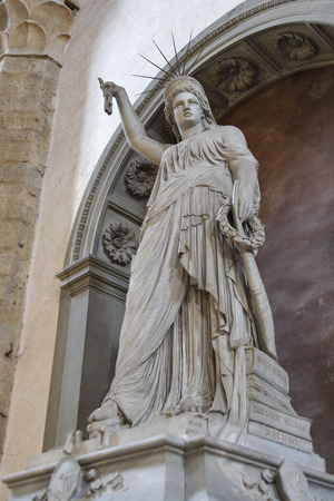 Statue of Liberty by Pio Fedi in Basilica Santa Croce in Florence, Italy. The Florentine statue represents the liberty of poetry and art by the lyre in the left hand and the broken chain held high in right hand.