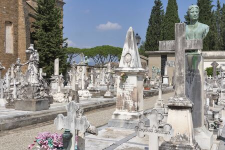 sante: FLORENCE, ITALY - SEPTEMBER 09, 2014: Graves and tombs of old cemetery delle Porte Sante close to Basilica San Miniato al Monte (St. Minias on the Mountain). The Porte Sante cemetery was laid out in 1854 atop one of the highest points in the city.