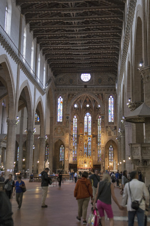 illustrious: FLORENCE, ITALY - SEPTEMBER 10, 2014: Unrecognizable people visit interior of the Basilica of Santa Croce or Basilica of the Holy Cross, built in the 15th century. It is the burial place of some of the most illustrious Italians, such as Michelangelo, Gali