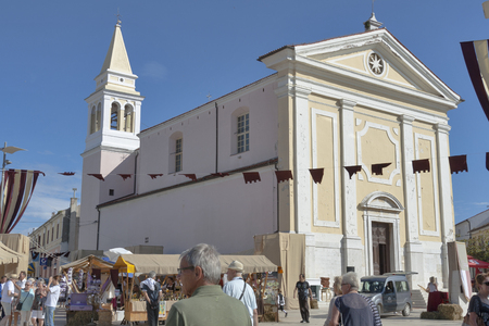 historical events: POREC, CROATIA - SEPTEMBER 14, 2014: People visit street market in front of Parish church of Our Lady of Angels at 8th Historical Festival Giostra. Most of its events are connected to the 18th century