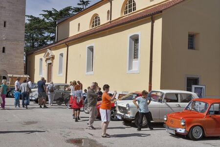 old timer: NOVIGRAD, CROATIA - SEPTEMBER 13, 2014: Unrecognizable people watch vintage cars on 5th International Old Timer Car Rally. The event organized by the old timer club Eppur si muove from Umag.