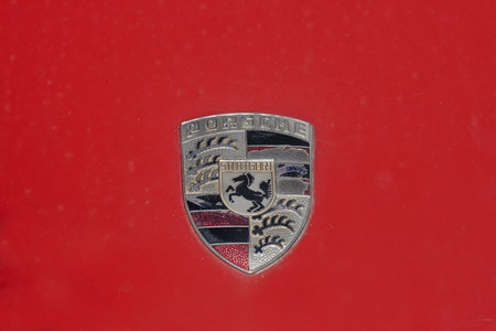 old timer: NOVIGRAD CROATIA  SEPTEMBER 13 2014: Vintage Porsche car emblem on 5th International Old Timer Car Rally. The event organized by the old timer club Eppur si muove from Umag.