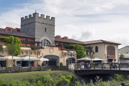 MUGELLO ITALY  SEPTEMBER 11 2014: People walk along McArthurGlen Designer Outlet Barberino situated in 30 minutes from Florence. McArthurGlen Group opened its first designer outlet in 1995. It has 20 designer outlets in the UK and Continental Europe now.