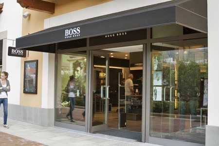 manequin: MUGELLO ITALY  SEPTEMBER 11 2014: People visit Hugo Boss store in McArthurGlen Designer Outlet Barberino close to Florence. Hugo Boss is a German luxury fashion and style house founded in 1924.