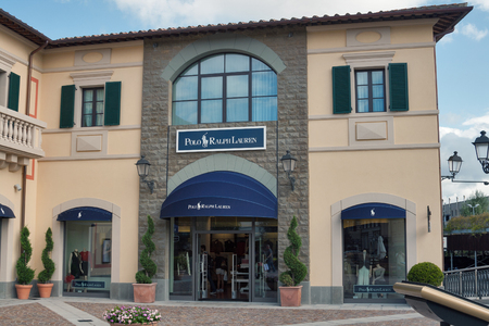 manequin: MUGELLO ITALY  SEPTEMBER 11 2014: People visit Polo Ralph Lauren store in McArthurGlen Designer Outlet Barberino near Florence. Ralph Lauren was founded in 1967 and headquartered in New York City. Editorial