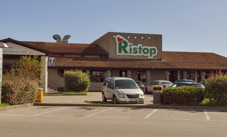 CESSALTO ITALY  SEPTEMBER 11 2014: Parked cars in front of autogrill Ristop open 24 hours a day for many different travellers who stop along the motorway. Airest is an Italy based food and retail operator with over 200 points of sale in 10 countries.